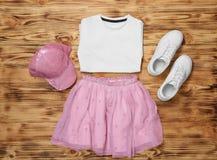 Insieme dei vestiti del ` s del bambino Fotografia Stock