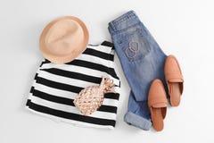 Insieme dei vestiti e degli accessori femminili Fotografia Stock