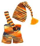 Insieme dei vestiti lavorati a maglia bambini: cappello e pantaloni. Fotografie Stock