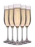 Insieme dei vetri del champagne con le bolle su un fondo bianco Fotografia Stock