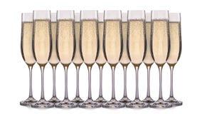 Insieme dei vetri del champagne con le bolle su un fondo bianco Fotografie Stock