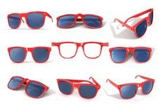 Insieme dei vetri di sole rossi Fotografia Stock Libera da Diritti