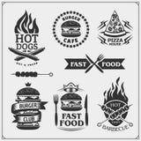 Insieme del BBQ Icone della bistecca, strumenti del BBQ ed etichette ed emblemi Fotografia Stock