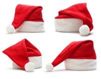 Insieme del cappello rosso del Babbo Natale Immagine Stock Libera da Diritti