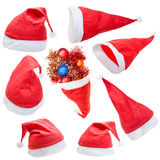 Insieme del cappello rosso tipico del Babbo Natale isolato Fotografia Stock Libera da Diritti