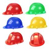 Insieme del casco della costruzione su un fondo bianco Immagine Stock Libera da Diritti