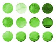 Insieme del cerchio dipinto a mano dell'acquerello verde isolato su bianco Illustrazione per progettazione artistica Macchie roto Fotografia Stock