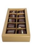 Insieme del cioccolato in una casella su priorità bassa bianca Fotografie Stock