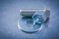 Insieme del dado dello screwbolt della rondella del bullone sul BAC metallico graffiato Fotografia Stock Libera da Diritti