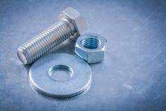 Insieme del dado inossidabile dello screwbolt della rondella del bullone sul BAC metallico Fotografie Stock