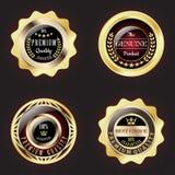 Insieme del distintivo premio dorato di qualità Immagine Stock