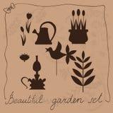 Insieme del giardino su un fondo beige con floreale Fotografia Stock