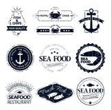 Insieme del logos dei frutti di mare Ristorante dell'aragosta del granchio Immagine Stock