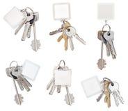 Insieme del mazzo di chiavi della porta con keychain in bianco Fotografia Stock Libera da Diritti
