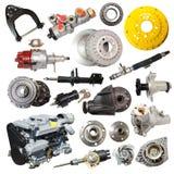 Insieme del motore e delle parti automobilistiche sopra bianco fotografia stock