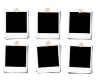 Insieme del telaio di film della foto della polaroid con nastro adesivo, isolato sugli ambiti di provenienza bianchi Fotografie Stock