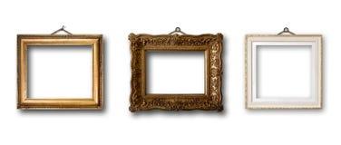 Insieme del telaio di legno dell'oro dell'immagine su fondo isolato Fotografie Stock