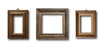 Insieme del telaio di legno dell'oro dell'immagine su fondo isolato Immagini Stock