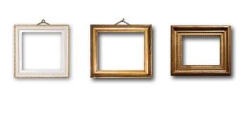 Insieme del telaio di legno dell'oro dell'immagine su fondo isolato Fotografia Stock