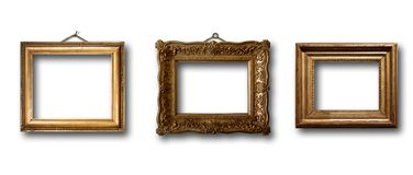 Insieme del telaio di legno dell'oro dell'immagine su fondo isolato Immagine Stock