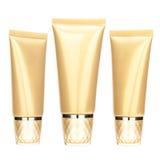Insieme del tubo del cosmetico dell'oro Immagini Stock Libere da Diritti