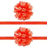 Insieme dell'arco e dei nastri a strisce rossi del regalo Fotografia Stock