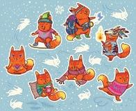 Insieme dell'autoadesivo di inverno dei caratteri delle volpi nello stile del fumetto Fotografia Stock Libera da Diritti