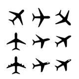 Insieme dell'icona e del simbolo dell'aeroplano in siluetta Fotografia Stock