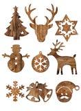 Insieme dell'isolato di legno delle decorazioni di natale su bianco Fotografie Stock