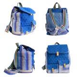 Insieme della borsa blu dello zaino su fondo bianco, zaino per il viaggio Immagini Stock
