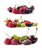 Insieme della frutta fresca e delle bacche Frutta e bacche isolate su priorità bassa bianca Uva passa matura, lamponi, ciliege, s Immagine Stock