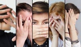 Insieme della gente che sta nascondendo il loro fronte con le dita fotografie stock