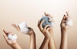 Insieme della mano della donna con sapone Fotografie Stock