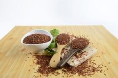 Insieme della raccolta del riso sulla siviera sul fondo di legno di struttura Fotografie Stock