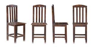 Insieme della sedia di legno scura su fondo bianco Immagine Stock