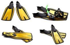 Insieme delle alette di nuotata, della maschera e della presa d'aria gialle per tuffarsi Fotografie Stock
