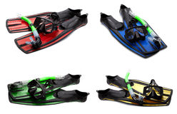 Insieme delle alette di nuotata, della maschera e della presa d'aria multicolori per tuffarsi Fotografia Stock