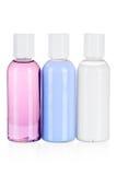 Insieme delle bottiglie cosmetiche isolate su un fondo bianco Fotografia Stock