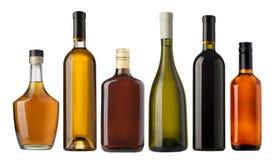 Insieme delle bottiglie del brandy e del vino Fotografie Stock