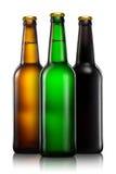 Insieme delle bottiglie di birra isolate su fondo bianco Fotografia Stock Libera da Diritti
