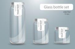 Insieme delle bottiglie di vetro trasparenti Immagine Stock