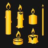 Insieme delle candele brucianti della siluetta dell'oro Fotografia Stock