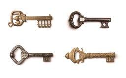 Insieme delle chiavi d'annata isolato su un fondo bianco Immagini Stock