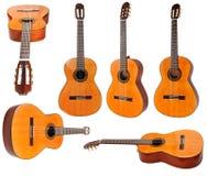 Insieme delle chitarre acustiche classiche isolate Fotografia Stock Libera da Diritti