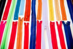 Insieme delle chiusure lampo multicolori Fotografia Stock