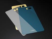 Insieme delle coperture colorate della plastica per il telefono cellulare su un fondo nero Fotografia Stock Libera da Diritti