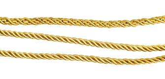 Insieme delle corde di seta dorate Fotografia Stock Libera da Diritti