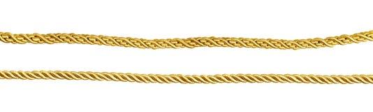 Insieme delle corde di seta dorate Immagine Stock