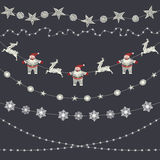 Insieme delle decorazioni di Natale, ghirlanda, fiocchi di neve, appli di festa Fotografie Stock Libere da Diritti