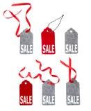 Insieme delle etichette del regalo di colore isolate su fondo bianco Fotografia Stock